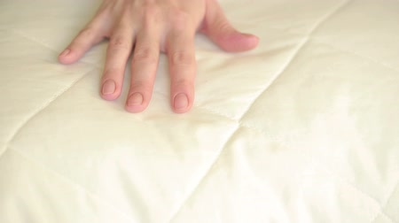 предъявитель : female hand pressing on the pillow. soft pillow