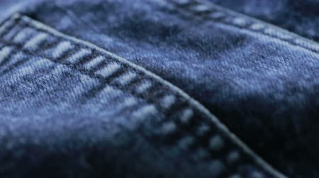 western wear : Blue jeans texture. can use as background. close-up of denim