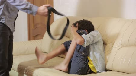taciz : Strict father punishing his son with a belt. parenting children