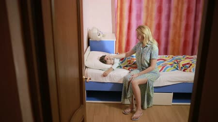 mother love : mother puts daughter to bed. baby sleep Stock Footage