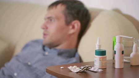 wasted : sick man lying in bed suffering virus having medicine tablets. drinking pill Stock Footage