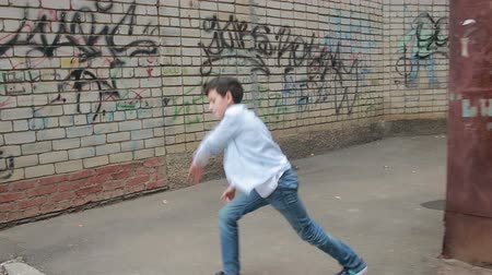 teen action : Teen boy dancing, street dancing on the background of brick wall
