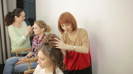 curling hair : barber makes the cut for woman