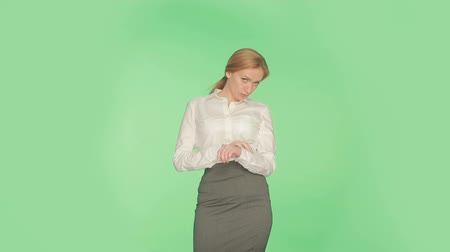 sexualita : Body language. Beautiful blonde girl in a white blouse on a green background.