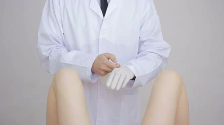 glove : Doctor gynecologist performing an examination Stock Footage
