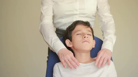 unconditional : Receiving healing energy, boy with female hands hovering over his forehead