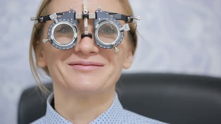 refractive : woman at the reception of an ophthalmologist. the selection of spectacle lenses