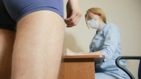 transmitted : a man is examined by a doctor of the urologist. woman doctor. inspects