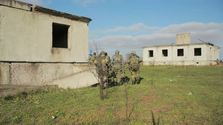 guerrilla : militias are fighting. Men in camouflage with guns and playing airsoft. war