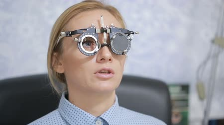 intraocular : woman at the reception of an ophthalmologist. the selection of spectacle lenses