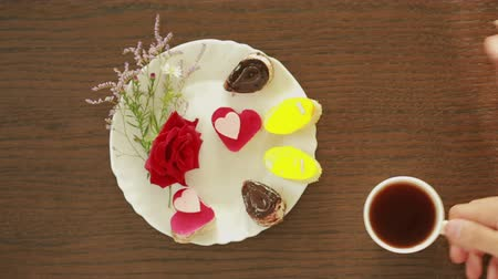 teabag : Black tea and coffee in mugs. table with a drink and dessert. Valentines Day