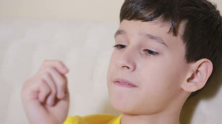 obsessive : Boy biting his nails obsessive-compulsive disorder, child psychology Stock Footage