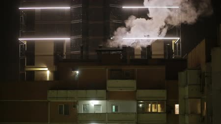 blokkok : winter cityscape. cranes. steam coming from the pipes. night Stock mozgókép