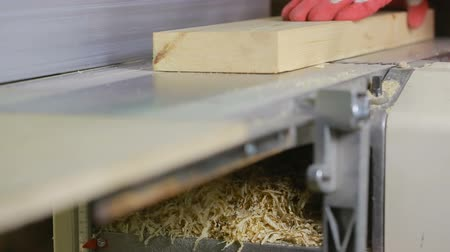 miter saw : The hands of man. Planing boards marking gauge machine.
