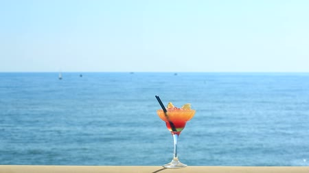 melão : cocktail on beach, blue sea and sky background