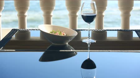 olive oil pour : A dish of a gourmet restaurant. Close-up. Pork with vegetables and a glass of red wine. Seaside restaurant