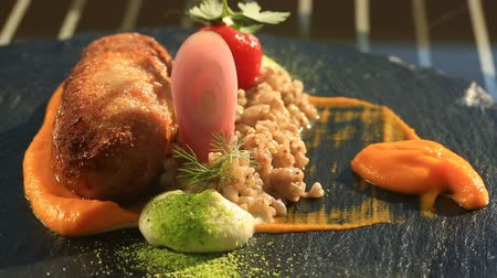 olive oil pour : Dishes at the gourmet restaurant. Close-up. Cutlet from rabbit meat with a garnish of green buckwheat