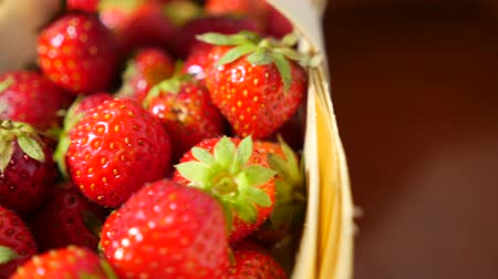 wiklina : Wicker basket with strawberry on the table, close-up 4k, dolly movement