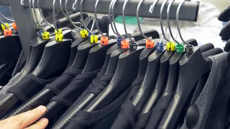casual wear businessman : man shopping in clothes store, choose clothes. 4k, slow motion