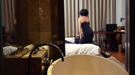 seductive : The concept of prostitution, industrial espionage. The brunette makes the businessman drunk and steals information from his laptop in the hotel room. 4k