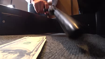 gengszter : someone opens a safe with weapons and money 4k, close-up