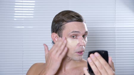greasepaint : Travesty make up. a young man makes himself a transsexual mencup. 4k, slow motion.