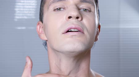 glamourous : Travesty make up. a young man makes himself a transsexual mencup. 4k, slow motion.