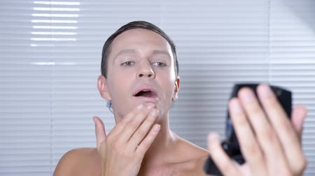divas : Travesty make up. a young man makes himself a transsexual mencup. 4k, slow motion.