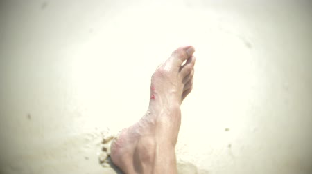 bleeding : human feet, cut about corals, while swimming in the sea. 4, slow motion