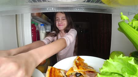 lodówka : girl teenager opens the refrigerator at night. night hunger. diet. gluttony, 4k