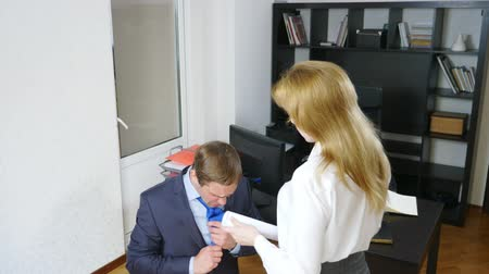 урод : humor, irony, female boss chastises the office worker who is standing in front of her on his knees, 4k