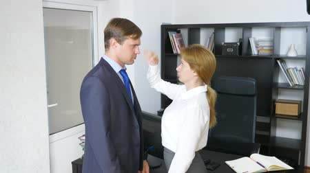 toborzás : Interview with the interlocutor or a meeting: a business man and a woman. humor, irony. 4k Stock mozgókép