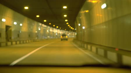 subdivisão : highway road tunnel, view from the window of a moving car. 4k, slow motion, blur.
