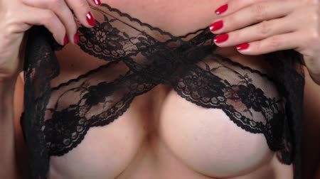 болваны : Topless beauty woman body covering her breast. 4k. Close-up. Slow motion. A woman with big breasts caresses her breasts. black lace.