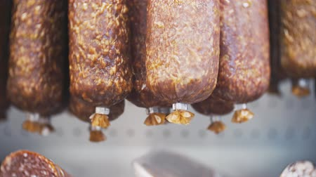 sombrio : smoked sausage on the counter in the store. 4k. close-up
