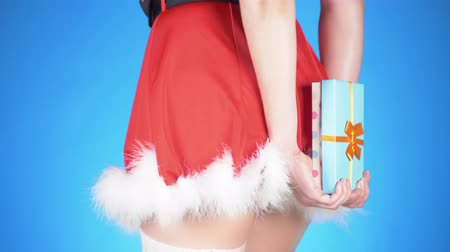 pom : Christmas Holidays. young attractive woman in a snow maiden costume with a gift, dancing on a blue background. close-up, slow motion, 4k Stock Footage