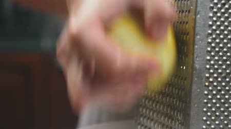 grated : woman rubs on grated lemon peel, close-up, slow-motion shooting, 4k, dolly shot Stock Footage