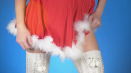 stockings : Christmas holidays. young attractive woman in a Snow Maiden costume dancing on a blue background. close-up, slow-motion, 4k