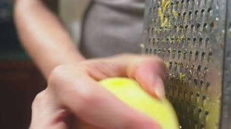 citron : woman rubs on grated lemon peel, close-up, slow-motion shooting, 4k, dolly shot Stock Footage
