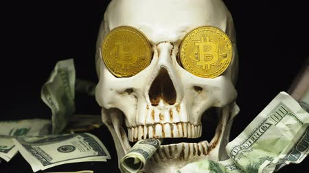 társult : Skull with US Dollar bills in his mouth. bitcoins on the eyes.