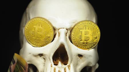 associated : Skull with US Dollar bills in his mouth. bitcoins on the eyes.