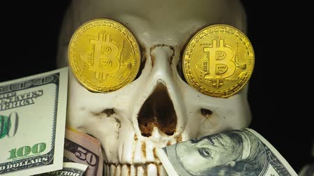 associados : Skull with US Dollar bills in his mouth. bitcoins on the eyes.