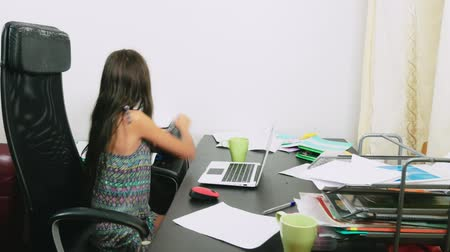 reciclado : the girl poured tea on the laptop. doing homework, online learning, 4k close-ups,