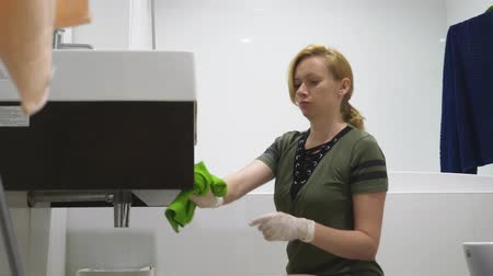 sanitize : woman housewife does the cleaning in the bathroom of her house Stock Footage