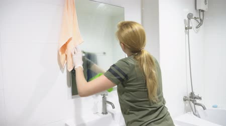 disinfectant : woman housewife does the cleaning in the bathroom of her house Stock Footage