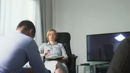 psychotherapist : Medical concept with psychologist visit. woman psychologist gives psychological counseling to a young man