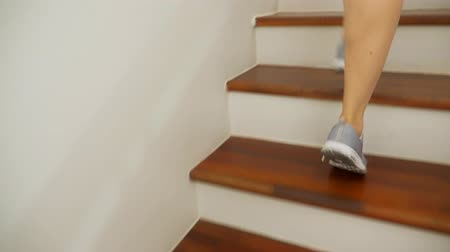 legs only : female legs in sneakers running along a wooden ladder Stock Footage
