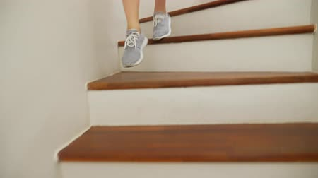 stepping : female legs in sneakers running along a wooden ladder Stock Footage