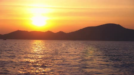 takımadalar : view from the sea to the island during sunset, seascape Stok Video