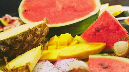 draak : Mixed tropical fruits, closeup. fresh fruit sliced. background.